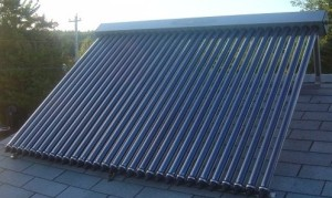 evacuated tube solar hot water installed on a roof frame.