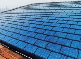 Flat solar tiles installed on a roof.